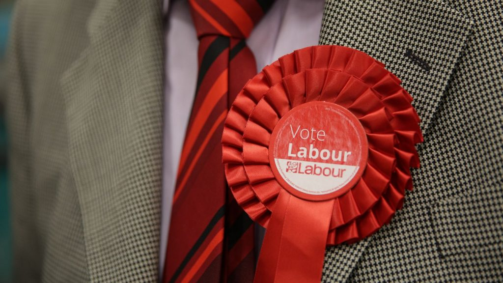 File photo of a man wearing a Labour rosette