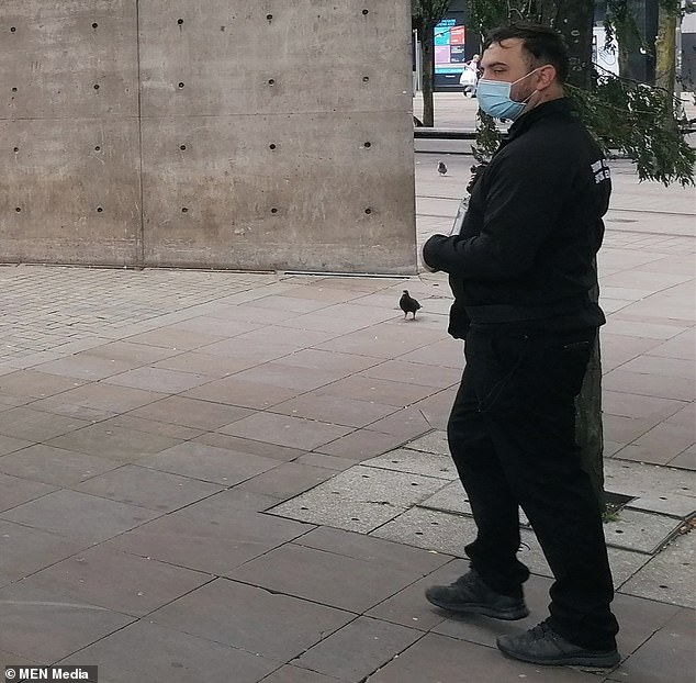 She was quickly collared by Piccadilly Gardens' enforcement officers (one pictured) who she claims demanded to see her ID before slapping her with the hefty penalty
