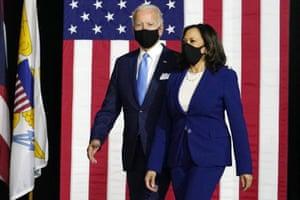 Joe Biden and Kamala Harris arrive to speak at a news conference in Wilmington, Delaware.