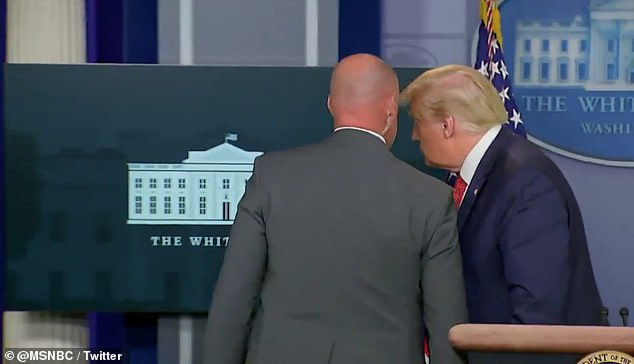 Shorty after he began speaking to the press, a Secret Service agent came into the press briefing room to whisper in President Donald Trump's ear
