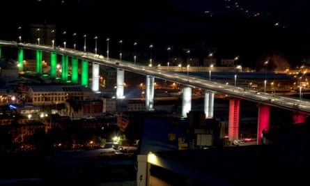 The 18 pillars of the new Genoa bridge illuminated with the colours of the Italian flag days before its inauguaration