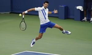 Djokovic in full flight as he returns a Milos Raonic rocket