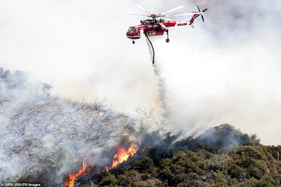 Helicopters were also used, pouring gallons of water on the fire in an attempt to contain the blaze