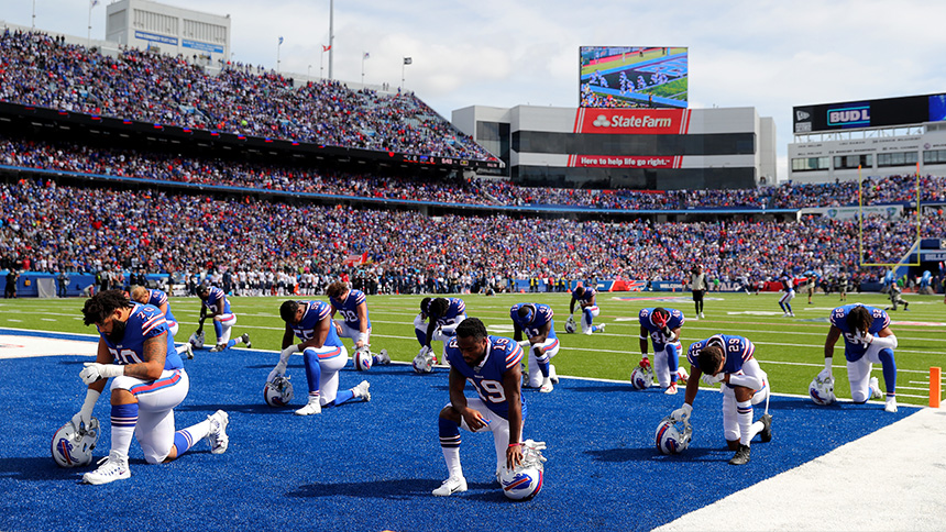 Players do not kneel on the field as the packed stadium looks.