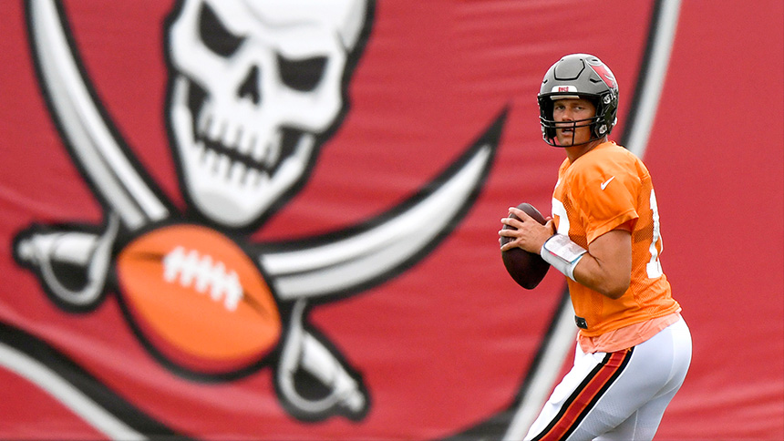 Tom Brady is ready to throw a football.