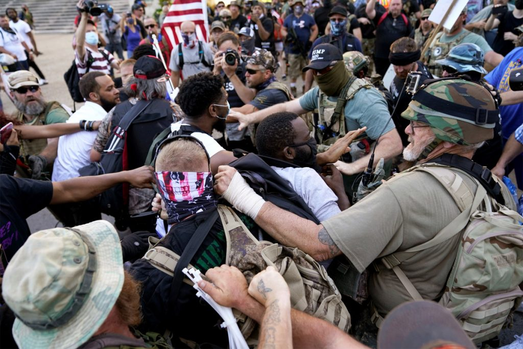 Militia, BLM protesters clash in Louisville over Kentucky derby
