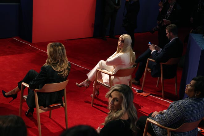 First Lady Melania Trump, left, Ivanka Trump, center, and Eric Trump sit next to each other during the first presidential debate on September 29, 2020, at the Case Western Reserve University Health Education campus in Cleveland, Ohio.