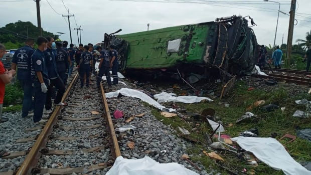At least 20 people have been killed in a bus-train crash in Thailand
