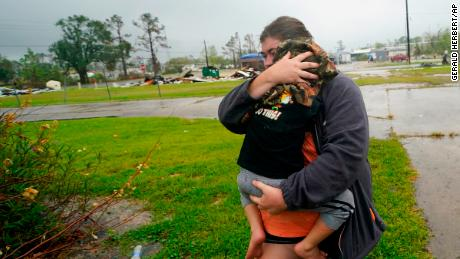 On Friday, October 9, 2020, at Lake Charles, Louisiana, before the Delta hurricane, Daniel Fontaine goes to a relative's house in the rain with his son Hunter.