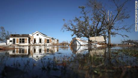 There were structures in the floodwaters on Saturday in Creole, Louisiana.