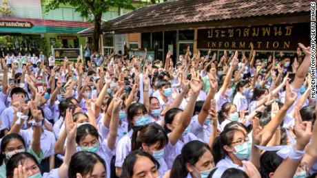 During a protest in Bangkok on October 2, 2020, students saluted three fingers at Samsen School, demanding less stringent school rules, more tolerance and respect.