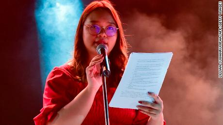 At a pro-democracy rally at Tammasat University on August 10, 2020, Panusaya Sitijiravattanakul read out a list of demands, including the repeal of the state's strict royal defamation law.