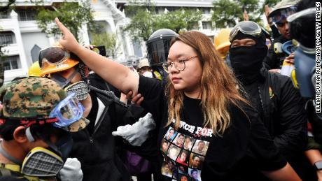 Protest leader Panusaya & quot;  Rang & quot;  Sitijiravattanakul (c) salutes the three-finger Hunger Games at a pro-democracy rally in Bangkok on September 20, 2020.
