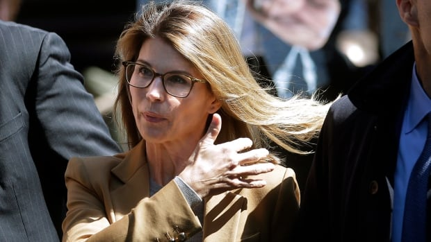 Actress Lori Laughlin has reported to jail over a college admissions scandal