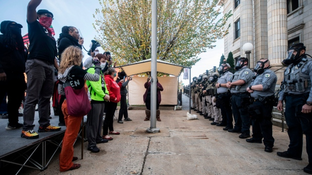 Police pepper spray, arrest participants in North Carolina voter rally