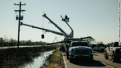 Utility crews work to restore power after a Delta hurricane landed on Peacon Island in Louisiana on Saturday, October 10, 2020.