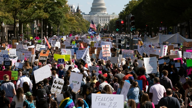 Women march outside White House demanding voters to reject Trump