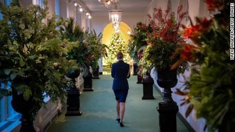 A military aide walks through the eastern colonnade as it decorates for Christmas at the White House on November 30, 2020.