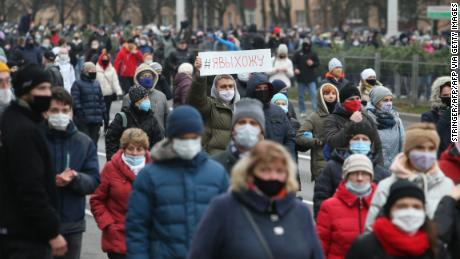 Belarusian opposition supporters wearing face masks rallied in Minsk on November 15 to protest the results of the Belarusian presidential election.