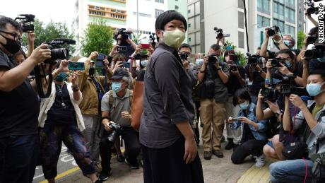 A Hong Kong journalist attends court as fears of repression grow