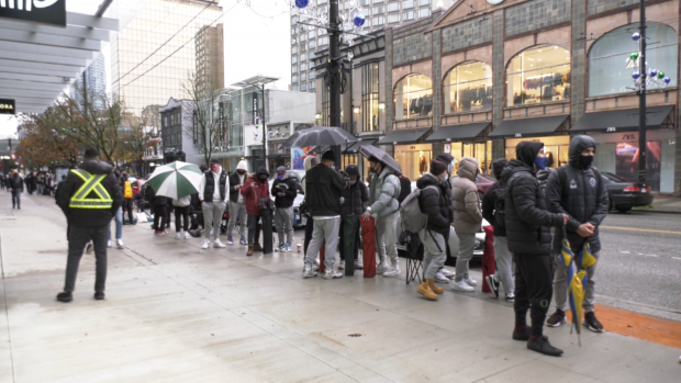 The foot locker launch attracts spectators in downtown Vancouver