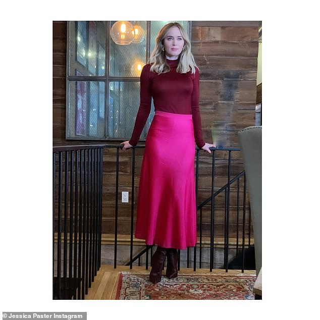 Seen on Instagram: Emily Blunt posed for a stunning photo on Tuesday in a long sleeve turtle maroon sweater top and a lovely bright magenta maxi skirt by St. John