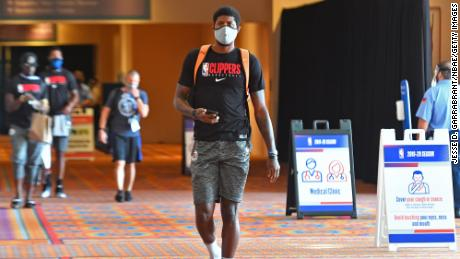 Paul George # 13 of LA Clippers arrives during practice on July 21, 2020 in Orlando, Florida as part of the NBA re-launch 2020.