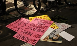 Signs of protest appear after a car rocks multiple people during a protest rally on December 11, 2020 in New York City.