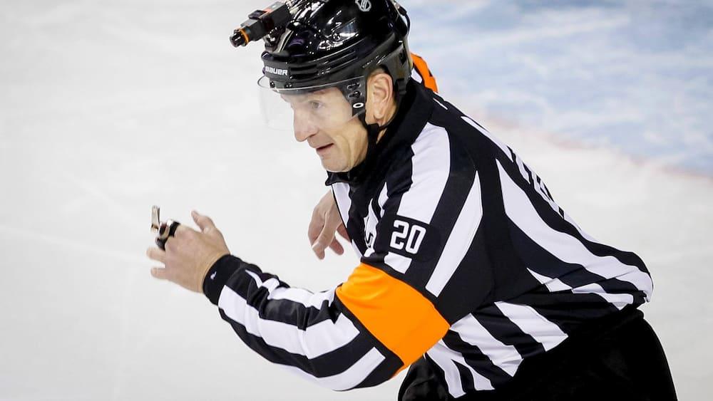 NHL Referee Tim Peel shows the door