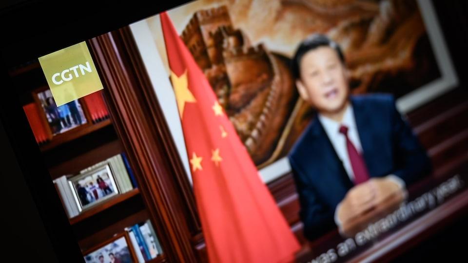 Chinese President Xi Jinping on TV screen.