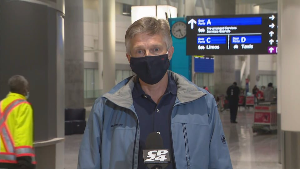 Rod Phillips at a press conference at Pearson Airport.