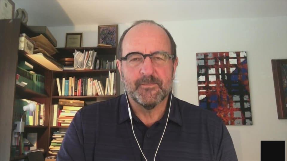 Dr. Alain Poyer via videoconference.