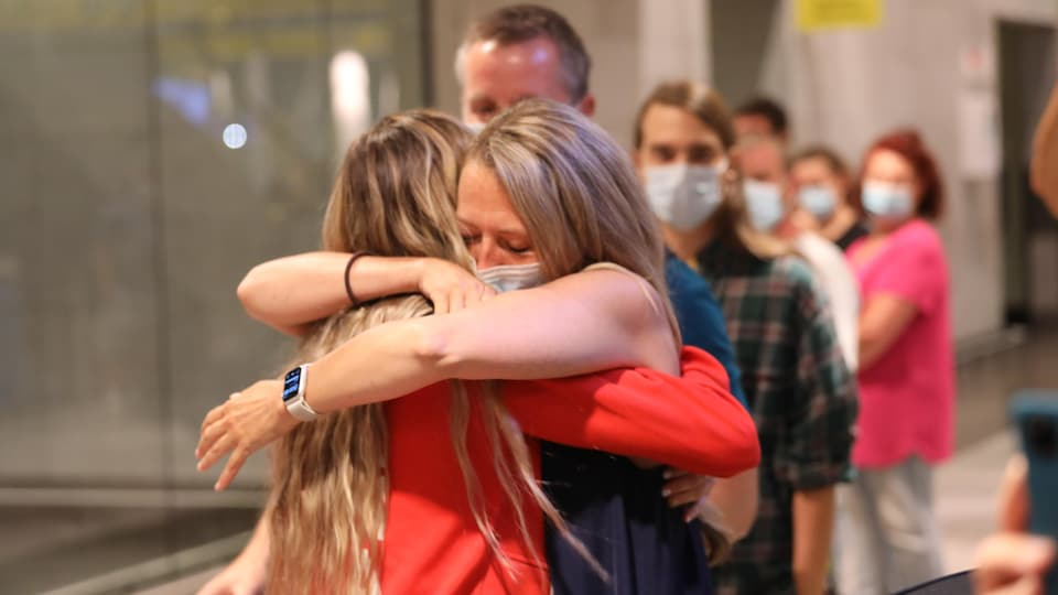 Gabrielle Carly and her mother hugged each other.