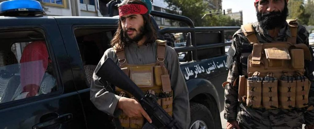 Afghan police are working with the Taliban at Kabul airport